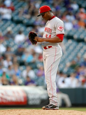 Cincinnati Reds pitcher Aroldis Chapman (54) reacts after walking a third straight batter during the ninth inning against the Colorado Rockies at Coors Field. The Rockies won 10-9.