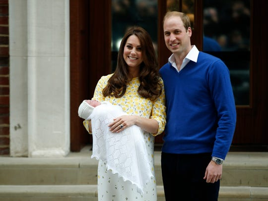 Britain's Prince William, right, and Kate, Duchess of Cambridge, hold their newborn daughter Princess Catherine as they pose for the media outside the St. Mary's Hospital's exclusive Lindo Wing, London, Saturday, May 2, 2015. The birth of Princess Charlotte may have contributed to the popularity of the female name in 2016 and 2017.