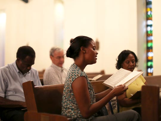 Ivana Kenny Carmola, center, sings during choir rehearsal at St. Michael & All Angels Episcopal Church in Tallahassee, which is celebrating its 135th Anniversary on Friday.