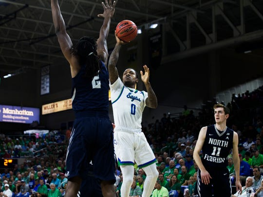 Florida Gulf Coast University guard Brandon Goodwin, #0, lays the ball up during the ASUN tournament semifinal game against North Florida at Alico  Arena on Thursday, March 1, 2018.