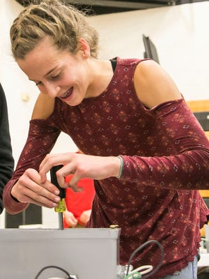 Ninth-grader Kiersten Lloyd laughs while competing at the electrical station during the STEM Summit Wednesday, Dec. 7, 2016, at Red Lion Area Senior High School. Amanda J. Cain photo
