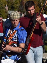 Clark Lundquist, left, and Erik Emanuelson of the band Papa Rick's Chicks perform at Sister Bay Bowl during last year's Fall Fest. The band is returning to play Sunday afternoon at Sister Bay Bowl for the festival.