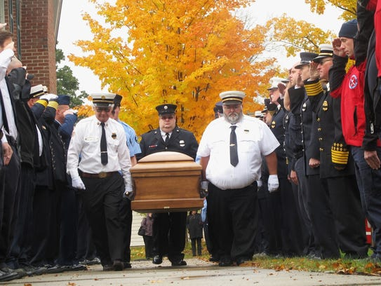 Firefighters make waySaturday for the casket of the