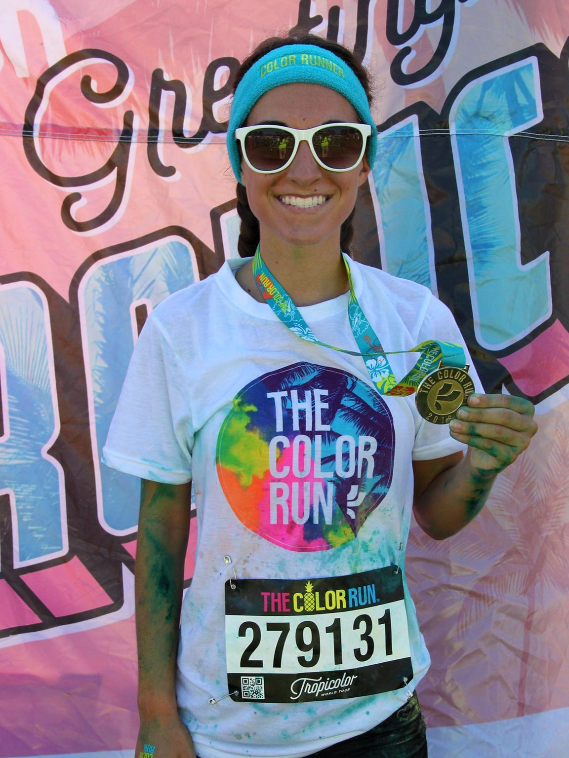 Abby shows off her Color Run gear after competing in