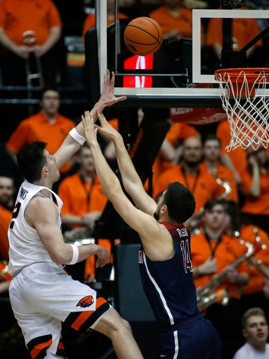 Oregon State's Drew Eubanks (12) shoots over Arizona's Dusan Ristic in the first half of an NCAA college basketball game in Corvallis, Ore., Thursday, Feb. 22, 2018. (AP Photo/Timothy J. Gonzalez)