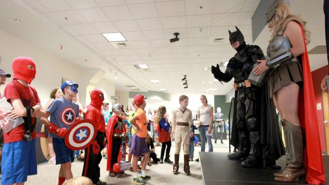 Young people in costumes gather to learn about the virtues of superheroes from cosplayers at the Electric City ComiCon at the Anderson County Library last year.