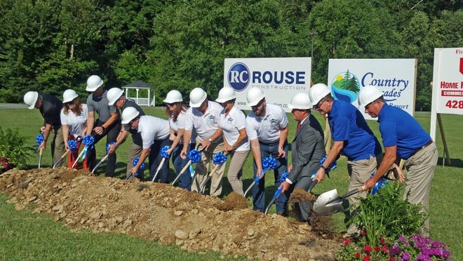 A groundbreaking ceremony in Pigeon Forge on Tuesday morning kicked off construction of an expansion to the Country Cascades Hotel and an associated water park. MAMIE NASH KUYKENDALL/NEWS SENTINEL
