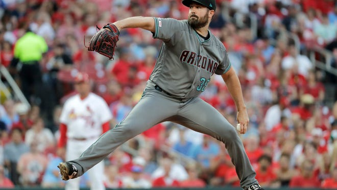 Arizona Diamondbacks starting pitcher Robbie Ray throws during the first inning of the team's baseball game against the St. Louis Cardinals on Friday, July 12, 2019, in St. Louis. (AP Photo/Jeff Roberson)