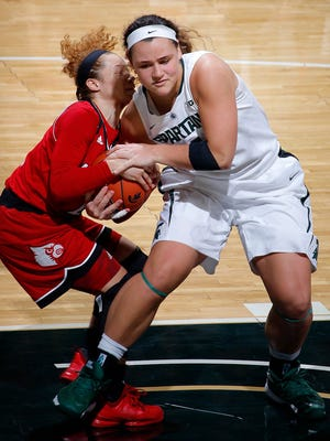 Michigan State's Jasmine Hines, right, and Louisville's Briahanna Jackson wrestle for the ball Thursday, Dec. 3, 2015, in East Lansing, Mich.