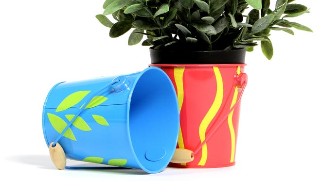 Colored duct tapes can be used to decorate planters.
