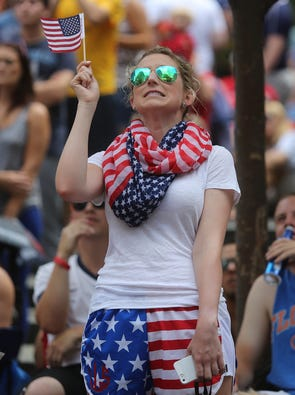 Lindsey Lewis of Downtown winces as she watches the US play Germany during a World Cup watch party Thursday on Fountain Square.