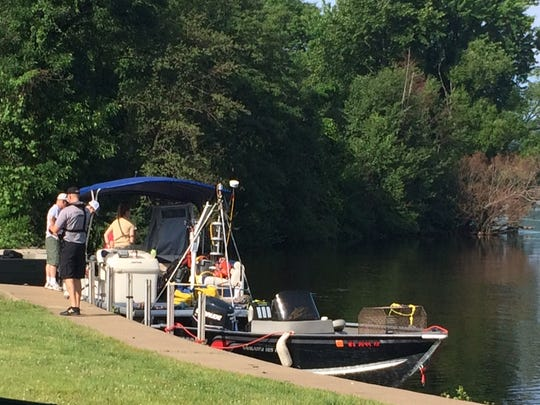 Emergency crews prepare to resume their search around 9 a.m. Friday for a father who went missing in Lake Wausau after trying to rescue his son.