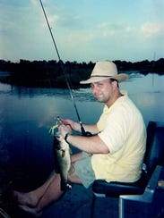 Michael fishing when he was younger