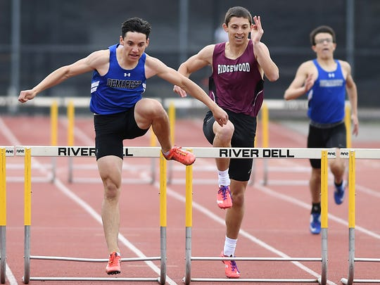 Bergen County Relays at River Dell High School on Friday, April 21, 2017. (left) Andrew Petersen, of Northern Valley Demarest, and Kyle Mack, of Ridgewood, compete in the 3x400 hurdles.
