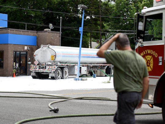 A gas tanker and the surrounding street are covered in foam after the tanker spilled gasoline while offloading at a Delta gas station at West Passaic Street and Palmer Avenue in Maywood on Sunday. Foam blankets were sprayed on the street to contain the spill.