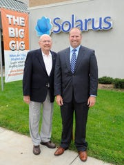 James H. Wenzlaff, left, president, board of directors and Douglas J. Wenzlaff, chief executive officer and general manager of Solarus in front of Solarus, Wednesday, Sept 3, 2014 in Wisconsin Rapids.