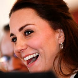Britain's Kate, Duchess of Cambridge laughs as she mingles with members of the British community in New York from culture, arts, hospitality, and business before a luncheon at the residence of the British Consul General in New York, December 8, 2014. Studies of laughter show the science behind the ancient form of communication is no joke.