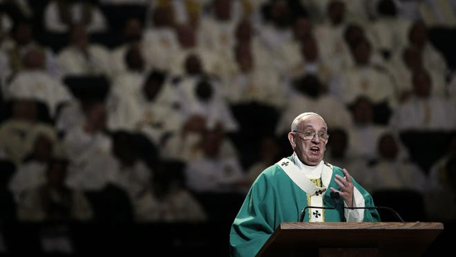 Pope Francis reads his homily while celebrating high Mass at Madison Square Garden, Friday, Sept. 25, 2015, in New York.