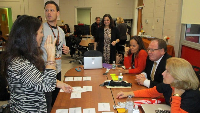 Education consultant Stefani Hite, center, discusses research on top teaching techniques with Linden public school administrators, (from left) Antoinette Modrak, coordinator of special projects, William Mastriano, principal of School No. 6, Suzanne Olivero, vice principal of School No. 4, Anthony Cataline, principal of School No. 4, and Sandra Coglianese, principal of School No. 10.