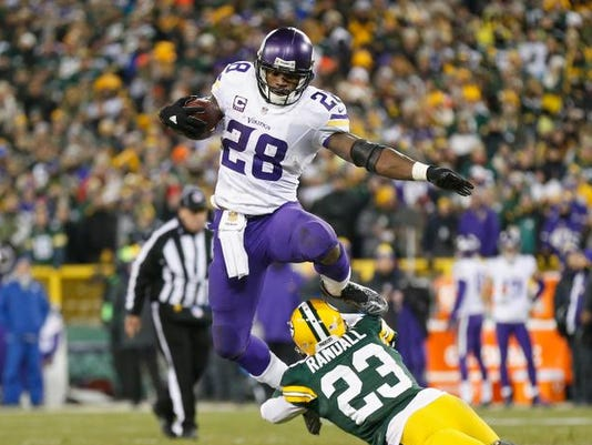 FILE - Adrian Peterson Signs With Saints Minnesota Vikings v Green Bay Packers