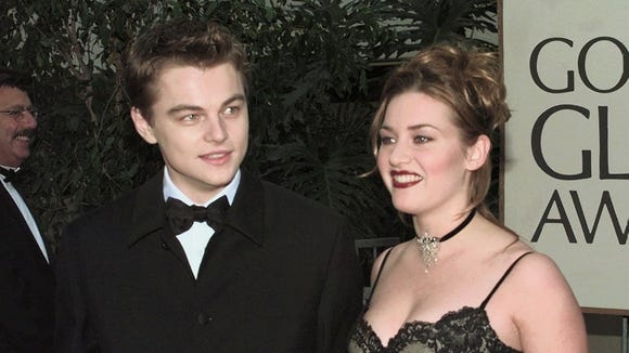Leonardo DiCaprio and Kate Winslet arrive at the 55th Annual Golden Globe Awards Sunday, Jan. 18, 1998.