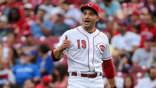 Cincinnati Reds first baseman Joey Votto (19) gives Cincinnati Reds third baseman Eugenio Suarez (7) (not pictured) a thumbs up after recording an out during the National League baseball game between the Chicago Cubs and the Cincinnati Reds, Tuesday, Aug. 22, 2017, at Great American Ball Park in Cincinnati.
