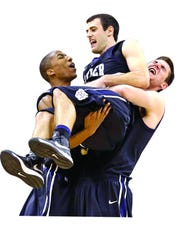 Alex Barlow is hoisted by his Butler teammates. Barlow