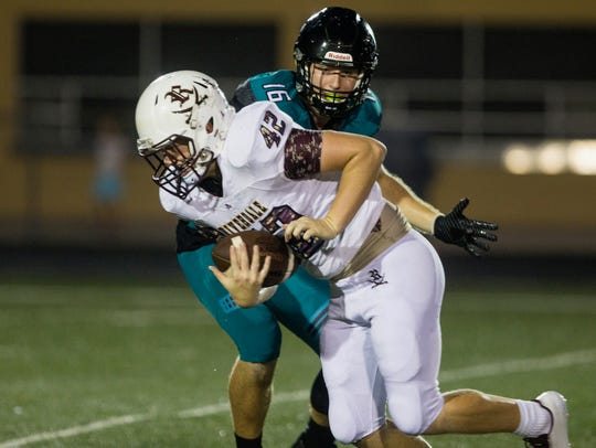 Riverdale High School defensive end Clay Cook successfully
