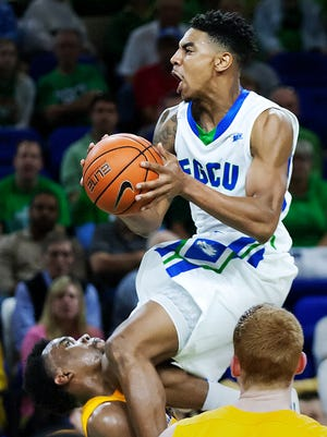 FGCU's Julian DeBose drives to the basket against Lipscomb on Thursday at Alico Arena in Fort Myers.