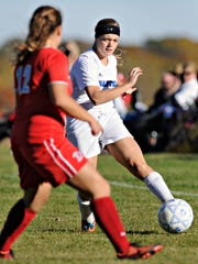 Sartell's Lexi Gent passes the ball past Detroit Lakes'