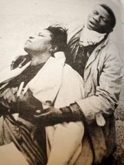 Amelia Boynton Robinson is comforted after being beaten on the Edmund Pettus Bridge in Selma on March 7, 1965.