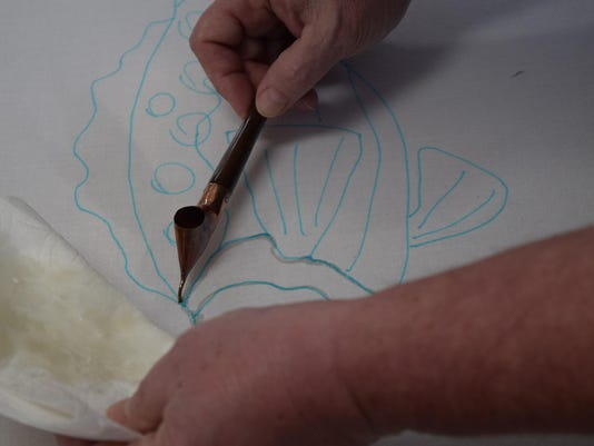 A tjanting is used to apply the wax to the batik project. Photo by Terry Sue B.
