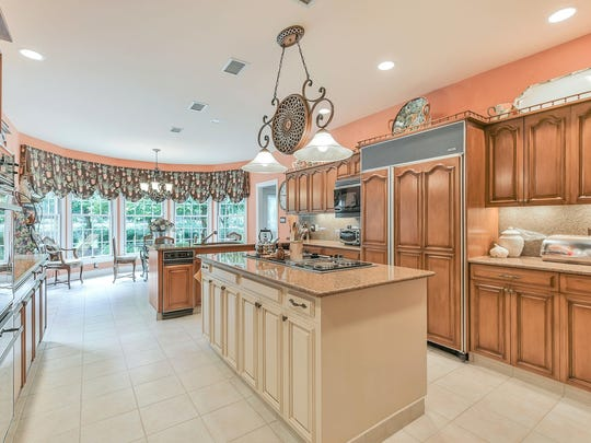With furniture-quality cabinets, a center island with a six-burner cook top and stainless-steel appliances, the kitchen is a chef's delight.