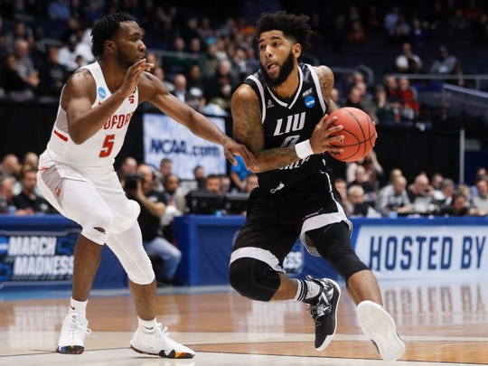 LIU Brooklyn's Joel Hernandez (0) drives against Radford's Donald Hicks (5) during the first half of a First Four game of the NCAA men's college basketball tournament, Tuesday, March 13, 2018, in Dayton, Ohio. (AP Photo/John Minchillo)