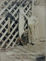 Morris Johns with a fresh catch of a tarpon in 1914.