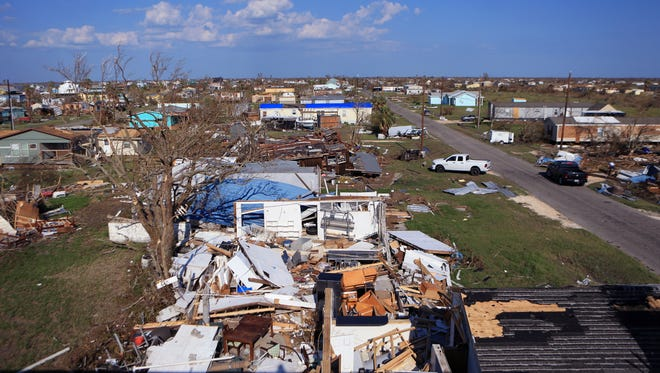 """An overhead view of Copano Cove in Rockport, TX on Aug. 30, 2017, shows the damage homes sustained in Hurricane Harvey. Before Hurricane Harvey the Aransas County Independent School District had an enrollment of 3,285 students. As of January 10, 2018, the enrollment was at 2,676 students. """"We'd like to get our students back,"""" said Joseph Patek, superintendent. """"We'd like to get those 500 and some back... That's only going to be able to be taken care of by homes and apartments being built."""""""