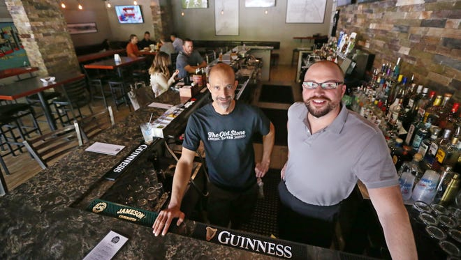 Owners Marc Taranto, left, and Jeff Wilczewski, right, at their newly opened Old Stone Tavern on South Avenue in Rochester Wednesday, July 25, 2018.  The neighborhood bar is in the former Orbs location, at 758 South Ave.