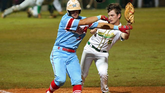 J.L. Mann's Blake Brady. left, collides with Summerville first baseman Jonny Watts, who was trying to field an errant throw in Game 2 of the Class AAAA baseball state championship series in Summerville Wednesday night.