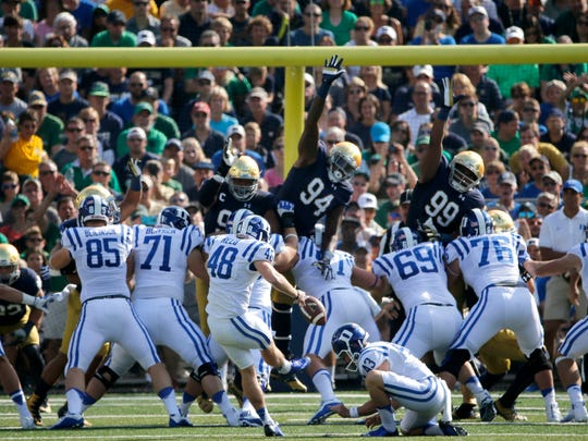 Duke place kicker AJ Reed (48) boots the extra point after Shaun Wilson's  kickoff-return for a touchdown during the first half of an NCAA college football game against Notre Dame, Saturday, Sept. 24, 2016, in South Bend, Ind. (AP Photo/Charles Rex Arbogast)