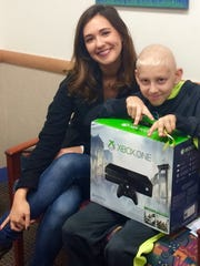 Liz Niemiec granted Wish No. 393, a gaming system delivered to a boy named Carson, who is being treated at Peyton Manning Children's Hospital at St. Vincent.