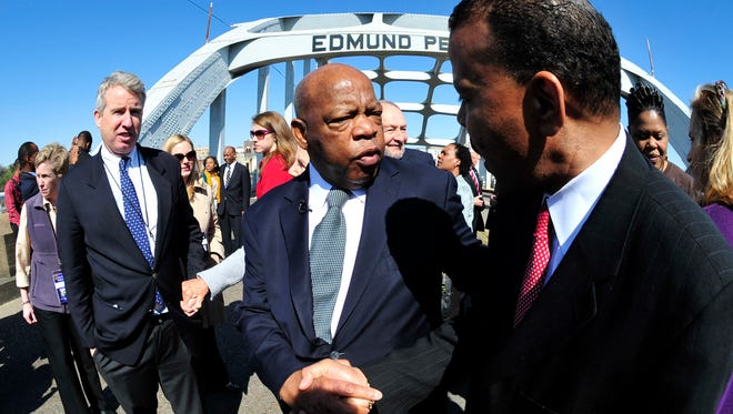 """U.S. Rep. John Lewis, D-Ga., is greeted by a well-wisher prior to the 47th recreation of the """"Bloody Sunday"""" civil rights march from Selma to Montgomery in 2012."""