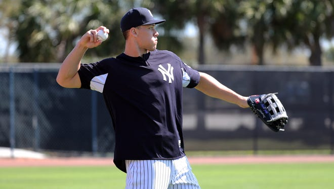 New York Yankees outfielder Aaron Judge (99) throws during spring training workouts at George M. Steinbrenner Field on Saturday, Feb. 17, 2018.