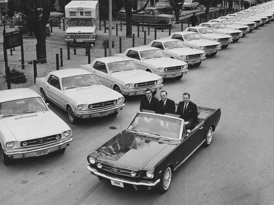 Donald Frey, Lee Iacocca and Henry Ford II at the New York World's Fair, for the first anniversary of the Mustang on April 15, 1965.