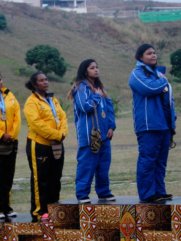 Members of the Guam women's national pistol team stand