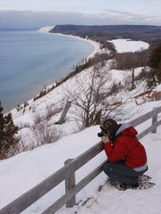 Photographer atop a dune at Sleeping Bear Dunes National Lakeshore in Empire, Mich.