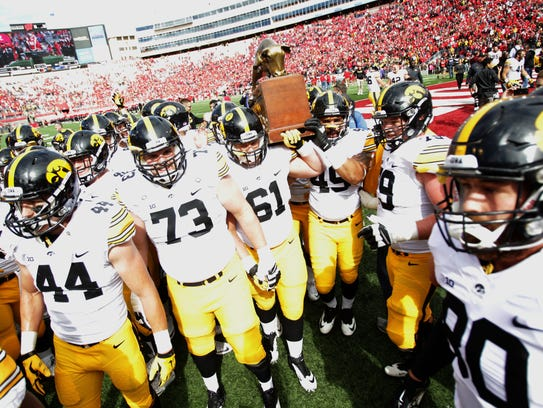 Iowa players celebrate the second of four trophy-game