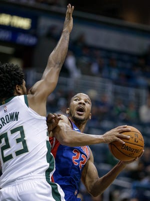 Bucks forward Sterling Brown defends Pistons guard Avery Bradley during the first half on Friday, Oct. 13, 2017, in Milwaukee.