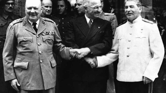 The handshake between Winston Churchill, left, Harry S. Truman and Josef Stalin, right in front of Churchill`s residence July 23, 1945, in Potsdam/Germany.