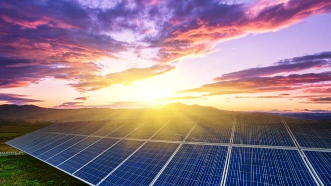 solar panels under blue sky on sunset