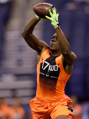 Michigan wide receiver Devin Funchess runs a drill at the NFL scouting combine in Indianapolis on Saturday, Feb. 21, 2015.